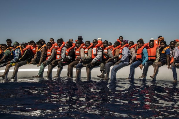 On driver African boat refugees